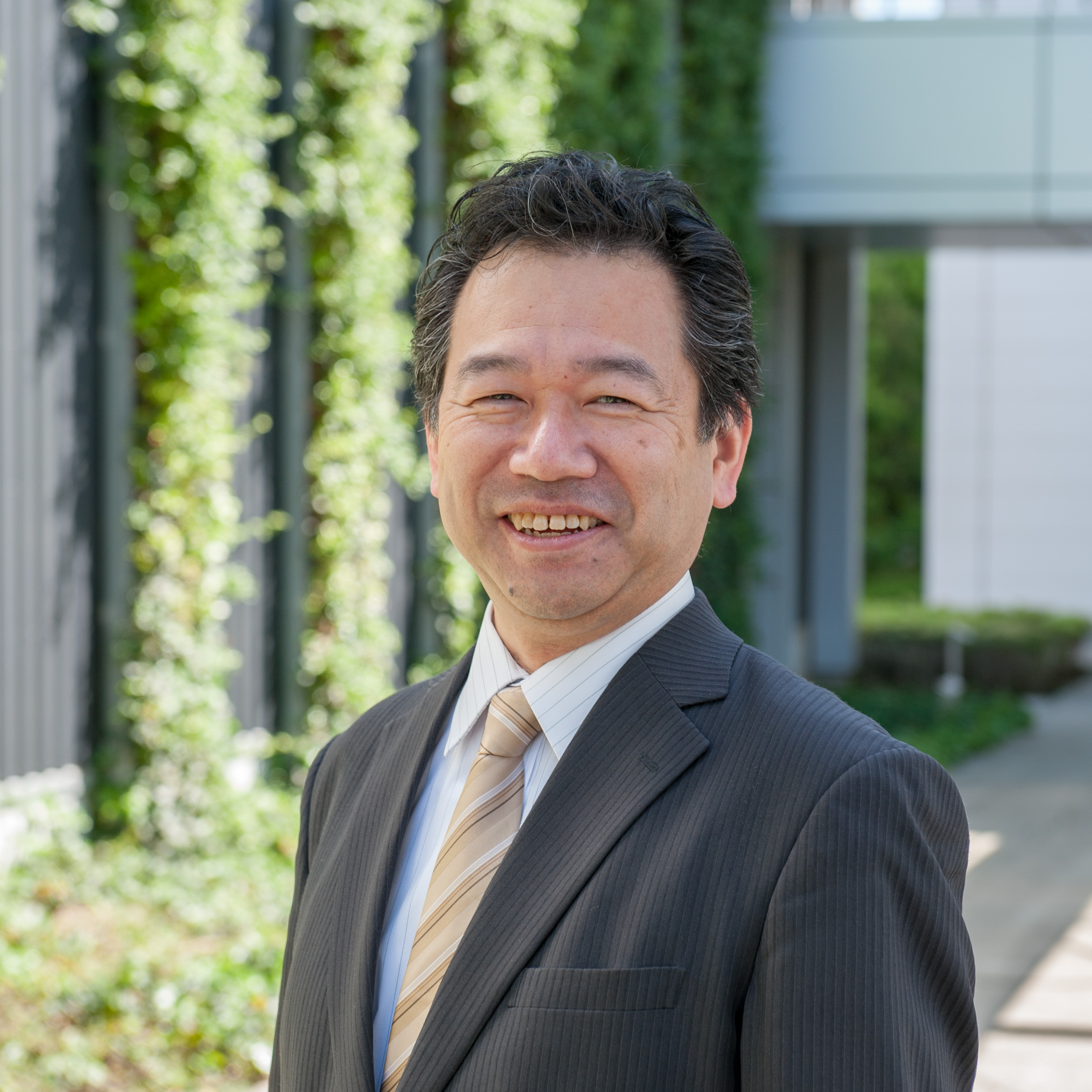 Mr. Tomoya  Kaneko